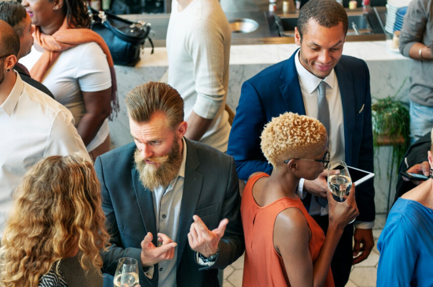diverse business people dinner party