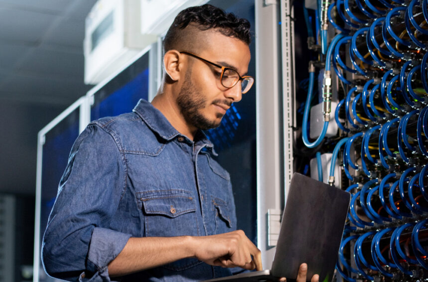concentrated network engineer examining database server